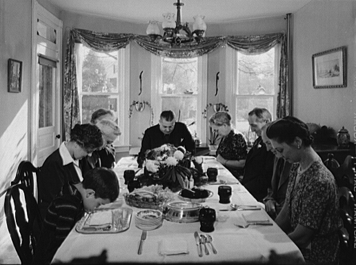 If this were a modern meal, these heads would be bowed to look at their phones.